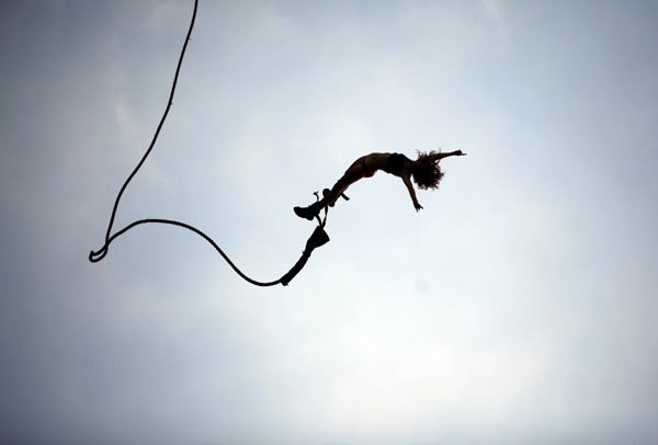 a-reveller-enjoys-a-bungee-jump-during-the-17th-woodstock-festival-in-kostrzyn-upon-odra-river-close-to-the-polish-and-german-border