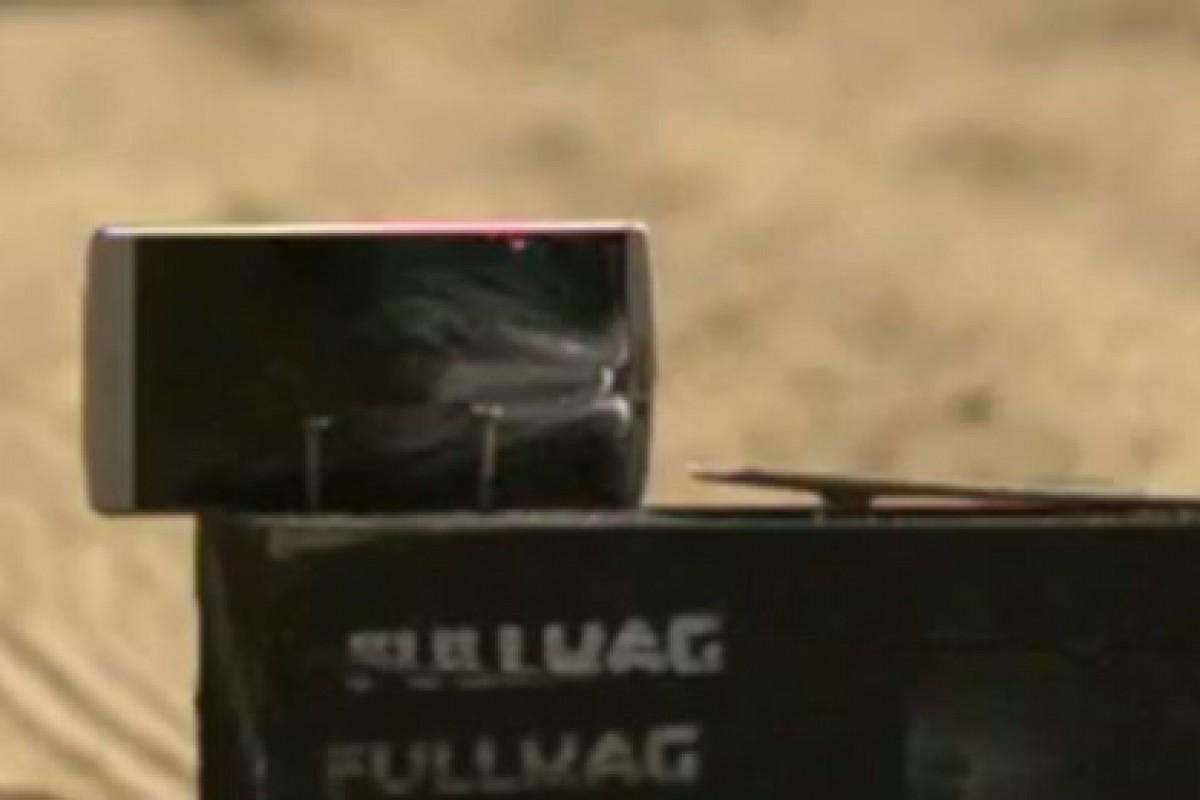 شلیک به گوشی الجی V10 با اسلحه کالیبر 50