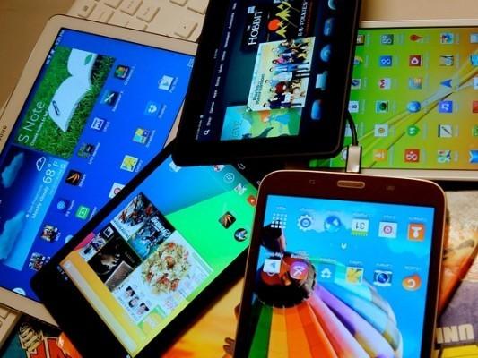 Espanol-pile_of_tablets-533x400-533x400