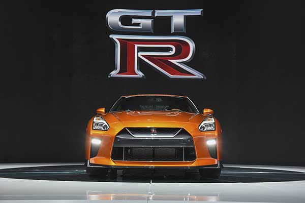 The Nissan Motor Co. 2017 GT-R sports vehicle is displayed during the 2016 New York International Auto Show in New York, U.S., on Wednesday, March 23, 2016. Nissan unveiled the latest version of its halo car, the Nissan GT-R. This is the latest update to the two-door, 2+2 sports car the company unveiled in 2007. Photographer: Ron Antonelli/Bloomberg