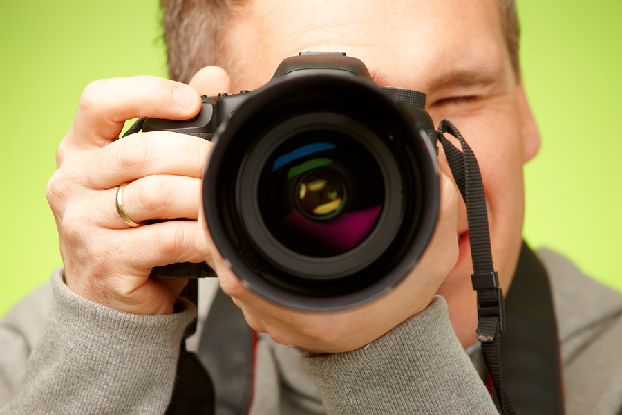 bigstock-Male-photographer-taking-photo-32517002