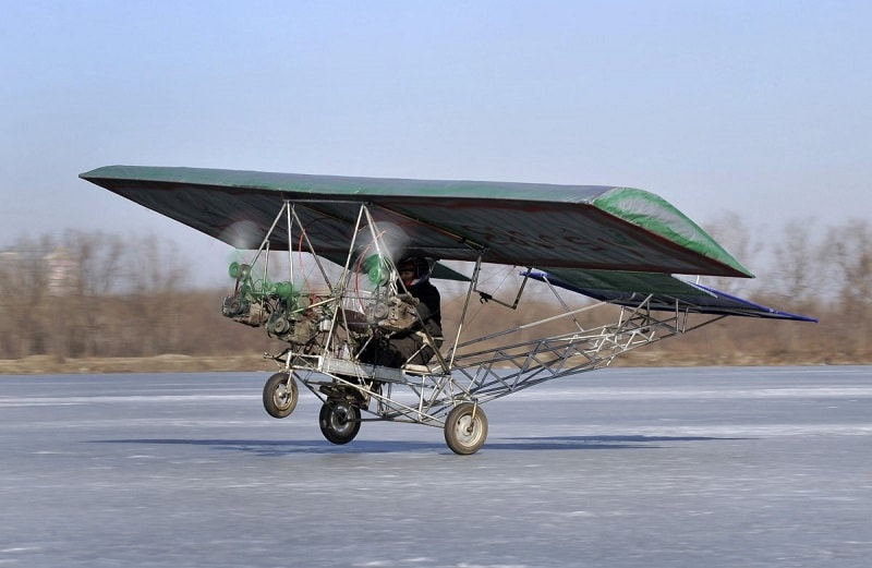 ding-shilu-an-automobile-mechanic-carries-out-a-test-flight-for-his-self-made-aircraft-at-a-frozen-reservoir-in-shenyang-liaoning-province-february-25-2011